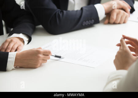 Negotiations about contract terms concept, hand pointing at docu - Stock Photo