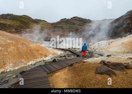Hikers, Steaming Soil, Seltún Geothermal Area, Krýsuvík Volcano System, Reykjanesfólkvangur National reserve, Reykjanes - Stock Photo