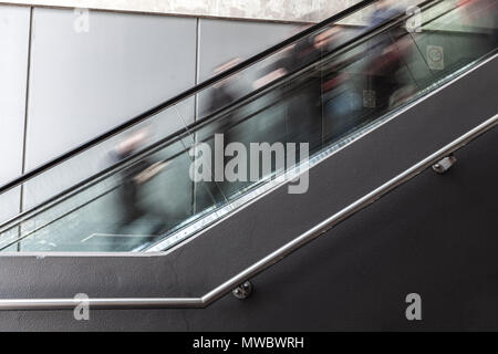 Blurred motion of people on escalator in Melbourne CBD - Stock Photo
