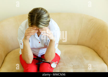 Crying unhappy upset medical nurse. Doctor sad and depressed having stress breakdown. - Stock Photo