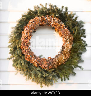 Colonial handmade Christmas wreath decorating the outside of colonial home. Every year Colonial Williamsburg residents craft and hang their creations. - Stock Photo