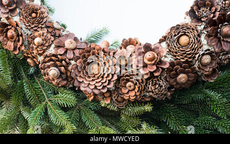 Christmas homemade natural wreath on display in Colonial Williamsburg. Closeup of detail. - Stock Photo