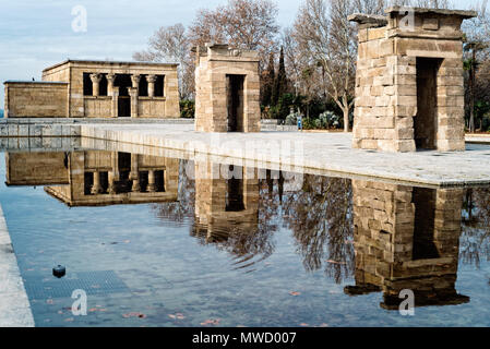 Egyptian Temple Of Debod in Madrid and water reflection Against Sky - Stock Photo