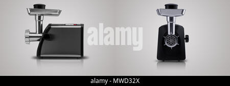 household electric meat grinder on a light gray background, two view positions. kitchen appliances - Stock Photo
