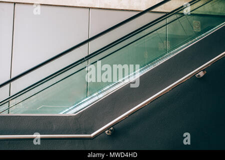 Fragment of escalator and handrail - geometric architecturall detail - Stock Photo