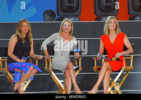 New York, New York, USA. 1st June, 2018. Halsey performs in the rain for Good Morning America at their summer concert series in New York's Central Park. Ginger Zee, Amy Robock, Lara Spencer Credit: Bruce Cotler/Globe Photos/ZUMA Wire/Alamy Live News - Stock Photo