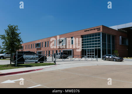 Dallas, USA. 1st June, 2018. Police cars arrive at the McKinney North High school, about 60 km north of Dallas, Texas, the United States, on June 1, 2018. Local officials confirmed Friday that a high school student died from a self-inflicted gunshot wound in McKinney North High School. Credit: Tian Dan/Xinhua/Alamy Live News - Stock Photo