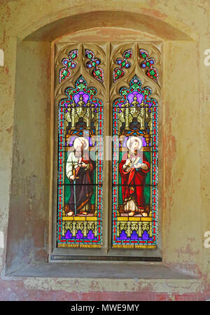 A stained glass window depicting St Paul and St Peter in the nave of the parish church at Horsey, Norfolk, England, United Kingdom, Europe. - Stock Photo