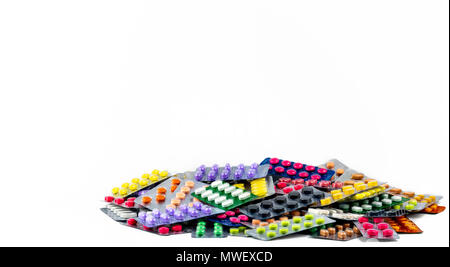 Pile of tablet pills isolated on white background. Yellow, purple, black, orange,  pink , green tablet pills in blister pack. Painkiller medicine. Dru - Stock Photo