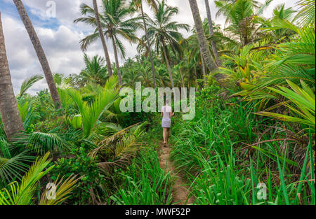 Itacare, Brazil - December 7, 2016: Trailway from havaizinho to Gamboa beach in the middle of woods - Stock Photo