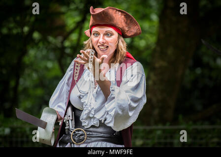 Acting - An amateur drama group in a performance at Trebah Garden Amphitheatre in Cornwall. - Stock Photo
