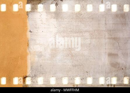 Grunge dripping cracked film strip frame in sepia tones. Wall surface. - Stock Photo