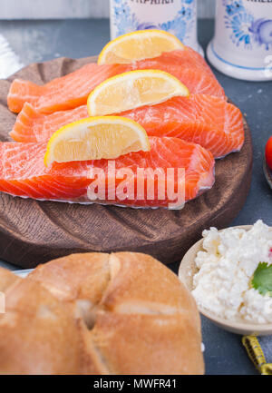 Salmon fillet with lemon, ingredients for cooking dinner. - Stock Photo