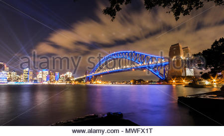 Sydney Harbour Bridge and Skyline. Illuminated by the Vivid Festival lights. 2018. - Stock Photo