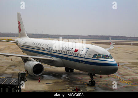 Wuhan, China - March 14, 2018: Air China Airbus A320 Neo aircraft parked at Wuhan airport - Stock Photo