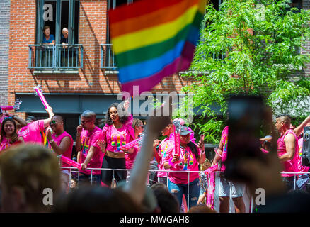 NEW YORK CITY - JUNE 25, 2017: Participants wave rainbow flags on a float in the annual Pride Parade as it passes through Greenwich Village. - Stock Photo