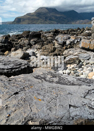 Drift ice abrasion marks on mudstone rock in foreground, Glen Scaladal Bay, Isle of Skye, Scotland UK. For closeups see images MWGBW0 & MWGBW2 - Stock Photo