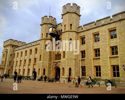 LONDON, UNITED KINGDOM - MARCH 4, 2017: A view of the Tower of London with tourists visiting the museum with clouds in the background. - Stock Photo