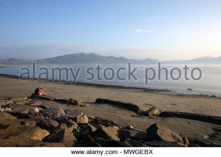 A beach near Castlegregory in County Kerry as the sun goes down at the end of a glorious day. - Stock Photo