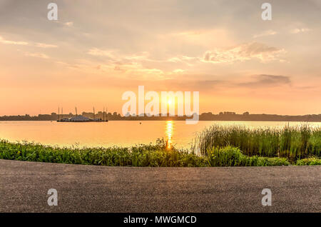 Sunset over lake Kralingse Plas in  Rotterdam, the Netherlands, as seen from the promenade on the eastern shore - Stock Photo