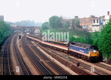 A class 47 diesel locomotive number 47707 working a charter train begins the climb of Acton Bank in west London on the 1st May 1993. - Stock Photo