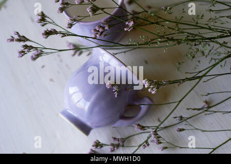 Gently purple bowl in the shape of a Bud, covered with icing. The skill of the ceramist. Gently purple bowl in the shape of a Bud, covered with icing. The skill of the ceramist. Dried flowers, tender cobwebs - Stock Photo