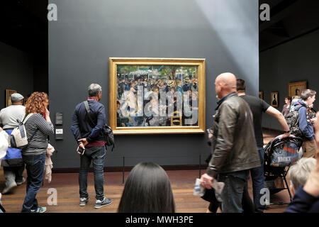 People visitors looking at painting Renoir painting 'Bal du moulin de la Galette' at Musée d'Orsay art gallery Left Bank in Paris France  KATHY DEWITT - Stock Photo