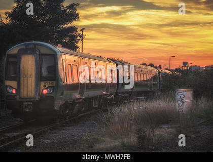 Sunset over the city of Birmingham from Tyseley train station - Stock Photo