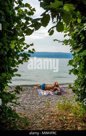 Couple at the edge of lake Geneva. Haute Savoie. France - Stock Photo