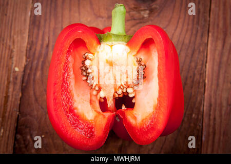 Looking on the inside of a red bell pepper. - Stock Photo