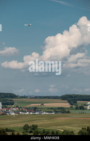 Little plane approaching and the green german countryside - Stock Photo