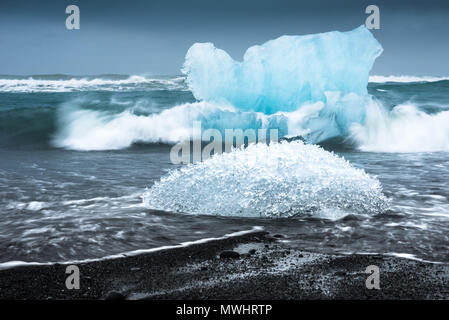longexposure image of two icebergs at Diamond Beach at Jökulsárlón - Stock Photo