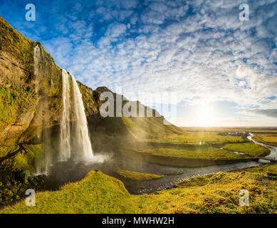 panoramic shot of one of the most beautiful waterfalls in Iceland. - Stock Photo