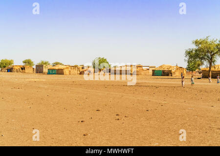 Al Quwaysi, Sudan - February 2, 2015: Children playing in front of the houses in small village near Al Quwaysi in Sudan. - Stock Photo