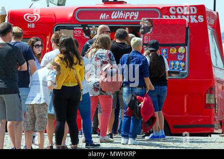 People queue for an ice cream from a Mr Whippy van during the hot weather - Stock Photo