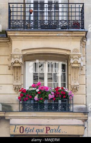 Colorful geraniums along a window balcony in Montmartre, Paris, France - Stock Photo