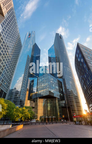 Setting sunlight over the financial district and modern architecture of La Defense, Paris France - Stock Photo