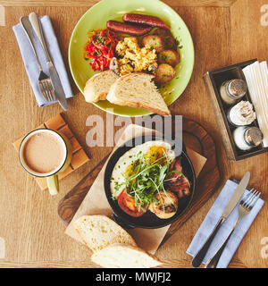 Brunch in restaurant with fried eggs and coffee - Stock Photo
