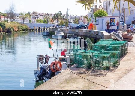 Ferragudo, Lagoa, Algarve, Portugal. Fishermen getting ready for the day's work. - Stock Photo