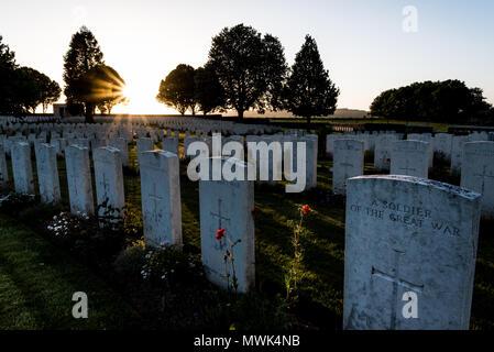 Cabaret Rouge British war cemetery at sunset, Souchez near Arras, northern France - Stock Photo