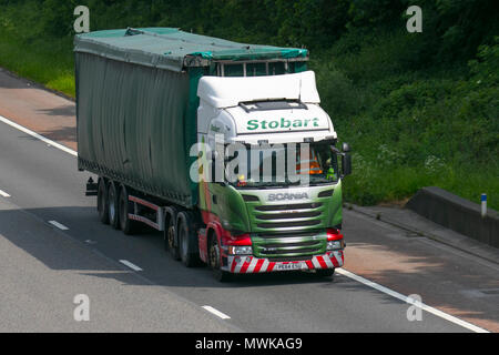 Eddie Stobart Scania commercial vehicles, haulage, lorry, transportation, truck, cargo, vehicle, delivery, transport, industry, freight on the M6 at Lancaster. UK - Stock Photo