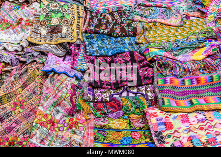Antigua,, Guatemala -  May 28, 2018: Typical colorful handwoven Guatemalan textiles made & sold by local indigenous women at markets in Guatemala - Stock Photo