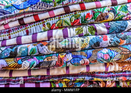Antigua,, Guatemala -  May 29, 2018: Colorful handwoven Guatemalan indigenous blouses called huipil made, worn & sold by local indigenous women - Stock Photo