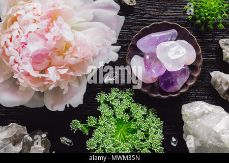 Amethyst and Quartz with Peony and Queen Anne's Lace on Dark Table - Stock Photo