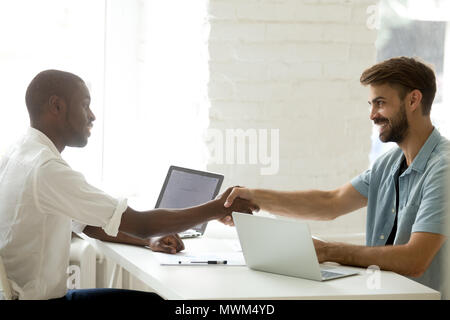 Business partners shaking hands greeting each other - Stock Photo