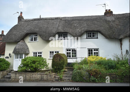 Thatched cottages in the village of Edington, Wiltshire, UK - Stock Photo