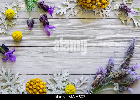 Lavender with Dusty Miller and Yellow Flowers on White Table - Stock Photo