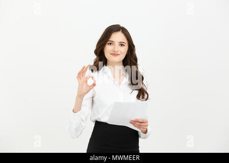 Business woman standing against white background. Smiling female business model studio posing. - Stock Photo
