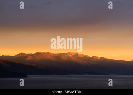 Stormy sunset over Freel and Job peak at Lake Tahoe looking south from Kings Beach area. - Stock Photo