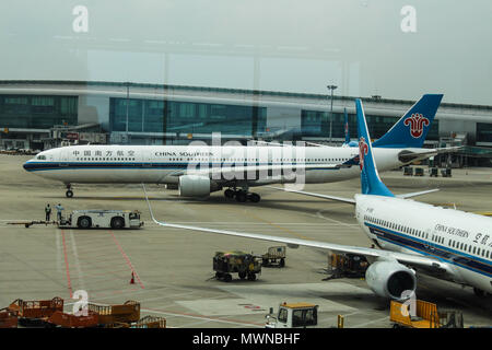 Wuhan, China - March 14, 2018: China Southern airplanes parked at Wuhan airport - Stock Photo
